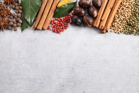 Aromatic spices on a gray ceramic background.