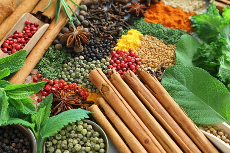 Colorful and aromatic spices and herbs. Food additives. Фото со стока
