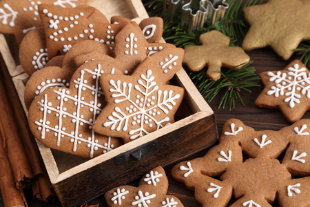Homemade gingerbread cookies on a dark background. Top view.