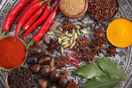 Aromatic Indian spices on a gray metal tray. Food and cuisine ingradients.