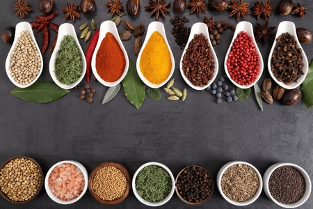 Aromatic Indian spices on a black background. Food and cuisine ingradients.