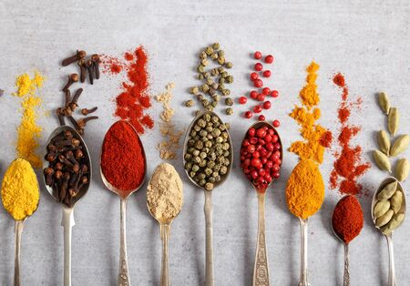Aromatic spices on spoons. Top view, flat lay.