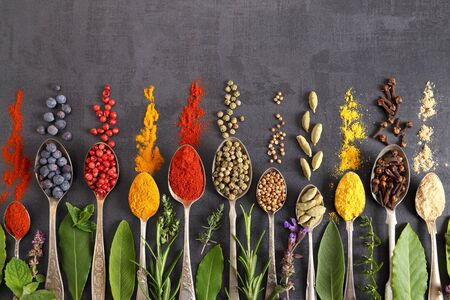 Aromatic herbs and spices on spoons. Top view, flat lay 写真素材