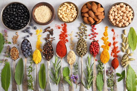 Aromatic herbs, spices on spoons and superfood . Top view, flat lay. 写真素材