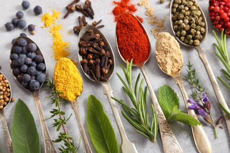 Aromatic herbs and spices on spoons. Top view, flat lay. 写真素材