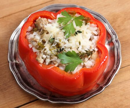 Stuffed pepper with rice, meat and cheese.