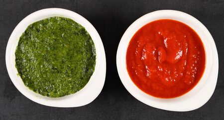 Green sauce and red pepper sauce. Top view. Flat lay.