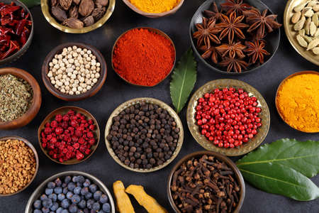 Spices in metal bowls. Food and cuisine ingredients. Colorful natural additives. Stock Photo