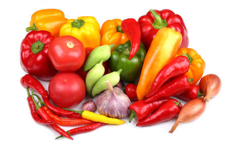 Colorful peppers, garlic and shallot on a white background.