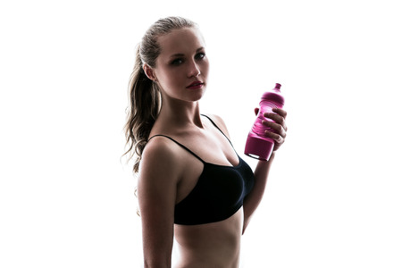 thirst: Sport girl is resting from training. She wants to drink a bottle of water