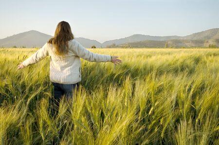 cornfield: Woman walking in a  cornfield near Santiago de Chile