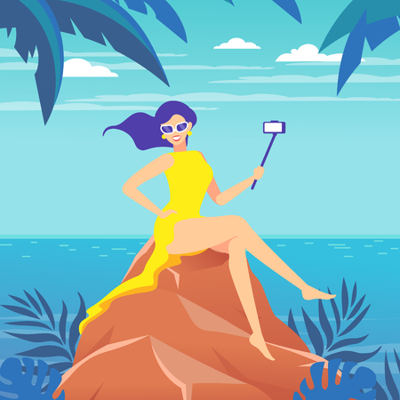 A woman takes a selfie, videotaping with the help of a selfie stick against the background of the sea landscape.