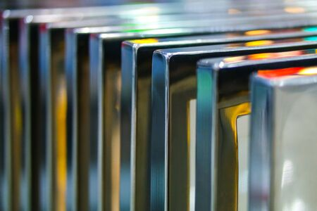 metal parts: many chrome metal parts in colored light Stock Photo