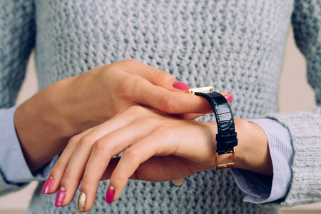 woman white shirt: Female hands with a bright manicure dress watch on wrist.