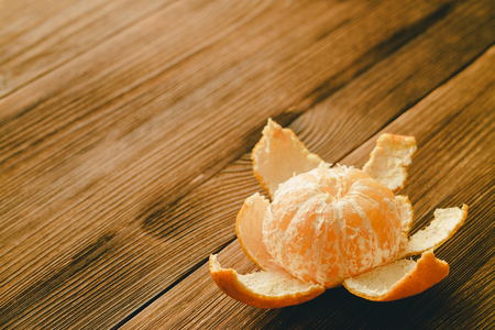 purified: Purified tangerine on a wooden table. Copy space.