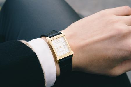 wrist cuffs: Classic wrist watch on a female hand closeup