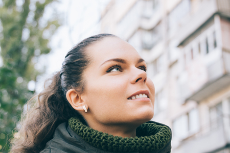 smile close up: Portrait of a young smiling woman in the city