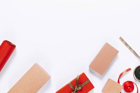 Wrapping gifts on a white table top view