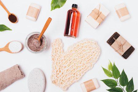 FLat lay background of natural bath cosmetics and accessories on white table. Stock Photo