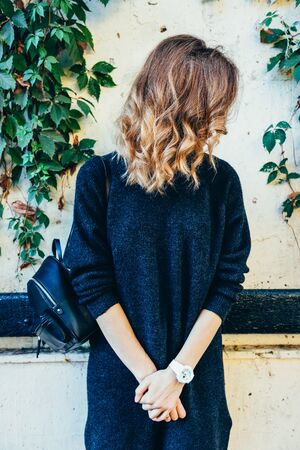 Woman with curly hair in a sweater, vertical image Banco de Imagens
