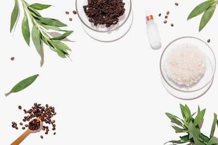 Flat lay composition of ingredients for homemade coffee scrub and cosmetic spa treatments on white background with empty place in center, top view. Stock fotó