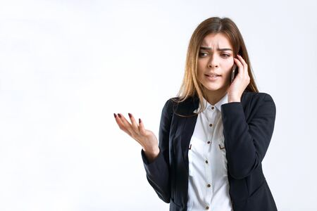 Cheerful brunette disturbed businesswoman have stressed phone talk on white isolated background with copyspace Stock Photo