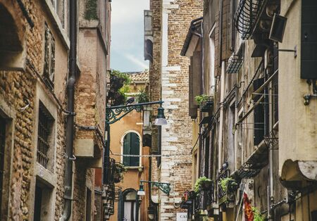 Venice, Italy - Aug 25, 2018: Venice street exterior with old buildings