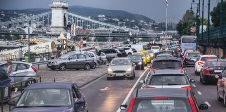 Budapest, Hungary - Aug 24, 2018: Evening car traffic near bridge in Budapest Editoriali