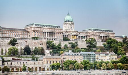 BUDAPEST, HUNGARY - 24 August, 2018: A Budapest city landscape, wide view on the King palace Budapest among green trees Editoriali