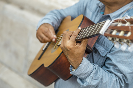 Croped view of street musician who plays on the guitar at the Budapest Reklamní fotografie