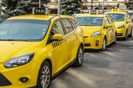Many yellow taxi cars standing on the Hungarian road 版權商用圖片