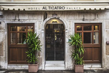 VENICE, ITALY - 25 August, 2018: View of the entrance in the form of semi-openware to the Al Theatro Palace hotel with pots with yucca standing on the sides