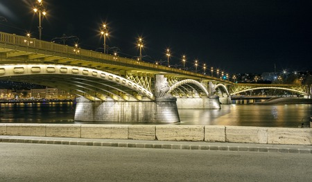 Night view on the Margaret Bridge and Danube River, many lanterns are lit in the city
