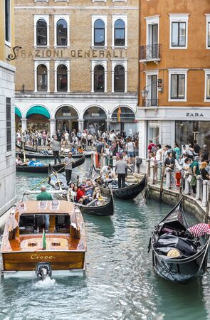 VENICE, ITALY - 25 August, 2018: Tourists on the Grand Canal Shopping Center, Venice