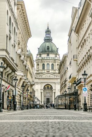 BUDAPEST, HUNGARY - 24 August, 2018: Street view of Budapest St. Stephens Basilica standing between the houses
