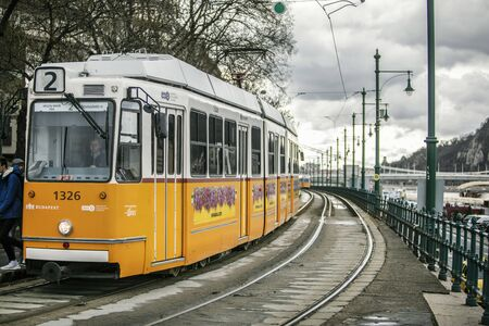 BUDAPEST, HUNGARY - 24 August, 2018: Retro yellow tram in Budapest in Hungary in a on a cloudy spring day