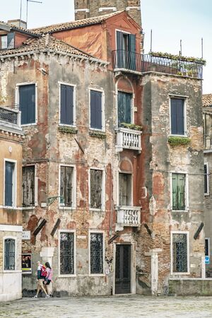 VENICE, ITALY - 25 August, 2018: Beautiful and colorful houses at Venice city with blue sky and cloud