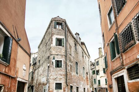 View of the old Venetian district with brick houses and wooden window shutters