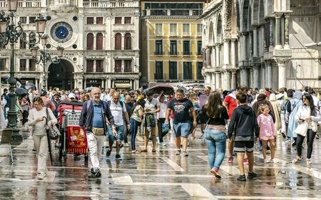 VENICE, ITALY - 25 August, 2018: Historic venecian square with tourists and locals