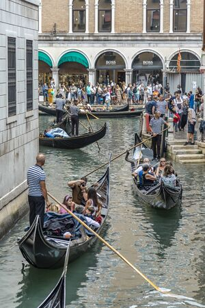 VENICE, ITALY - 25 August, 2018: The Grand Canal Shopping Center in Venetian and tourists ride on the Venetian boat Gondola Editorial