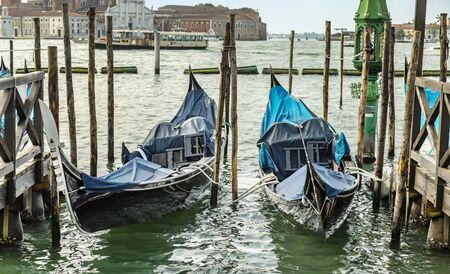 Gondolas in lagoon on the summer sky background, Venice, Italy