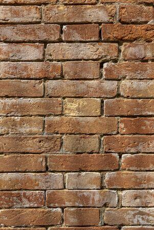 Old brick wall, old texture of red stone blocks closeup Archivio Fotografico