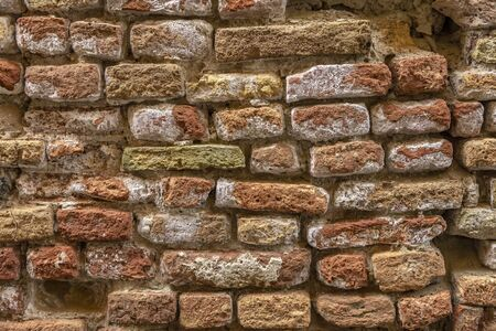 The texture of the brick. Background of empty brick basement wall