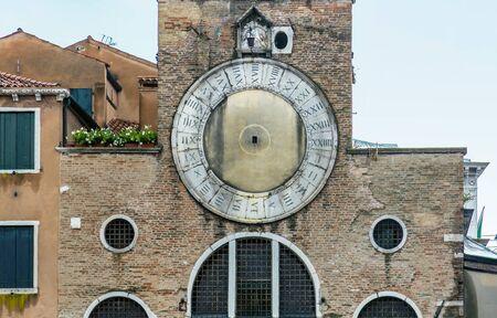 Fragment of Church of San Giacomo di Rialto or Chiesa di San Giacomo di Rialto in Venice Archivio Fotografico