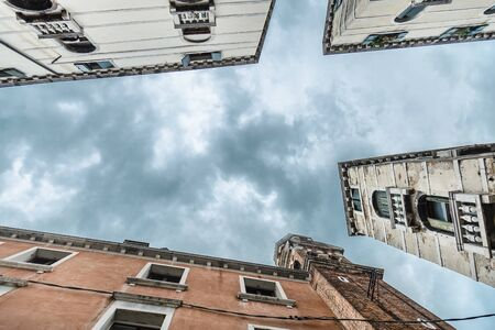 Bottom view among the houses on the summer sky Archivio Fotografico