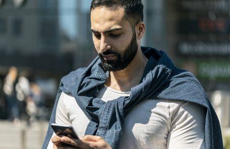 Attractive bearded business man sending message Stockfoto