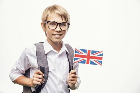 Smiling pupil in glasses holding British flag