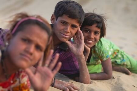 deprived: JAISALMER – DECEMBER 10 : Young Rajasthani kids in desert on December 10, 2010. About 40% of the total population of Rajasthan state live in the Thar desert Editorial