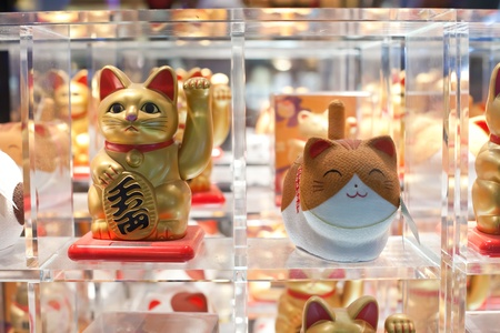 maneki: many maneki neko or beckoning cat in a window in Asia Editorial