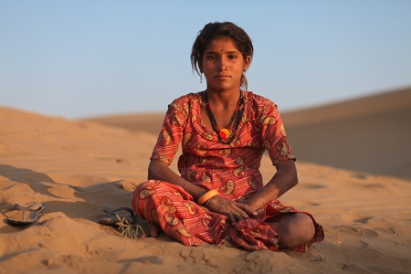 needy: JAISALMER DECEMBER 10 : Young Rajasthani girl in desert on December 10, 2010. About 40% of the total population of Rajasthan state live in the Thar desert
